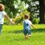 Children running outdoors — Stock Photo