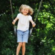 Little girl swinging — Stock Photo