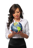 Young asian businesswoman holding the earth — Stock Photo