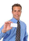 Businessman presenting card — Stock Photo