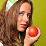 Brunette holding apple — Stock Photo #13416292
