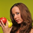 Young woman holding apples — Stock Photo #13565951