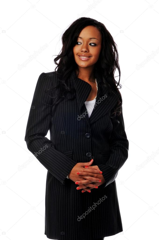Young African American businesswoman smiling isolated against a white background  Stock Photo #13565859