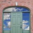 Door with clouds - Stock Photo