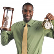 Businessman holding clocks — Stock Photo