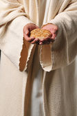 Jesus holding a bread and a wine — Stock Photo