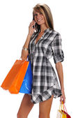 Young woman with shopping bags and cell phone — Stock Photo