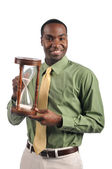 Businessman holding a sand timer — Stock Photo