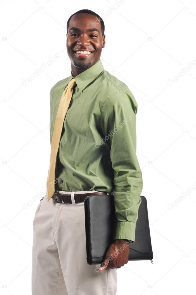 African american businessman holding a portfolio and smiling on a white background — Stock Photo #13738502