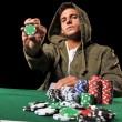 Stock Photo: Young man playing poker