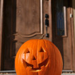Jack o-lantern by the door — Stock Photo