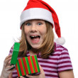 Little girl Santa with gift — Stockfoto
