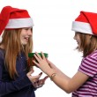 Two girls with christmas present — Stock Photo #13910626