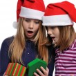 Two girls with christmas present — Stock Photo #13910629
