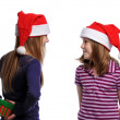 Two girls sharing a Christmas present — Stock Photo #13910635