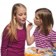 Young Girsl doing face paint — Stock Photo