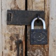Old grungy door with vintage lock - Stock Photo