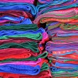Textiles at the indian market in Peru - Stock Photo