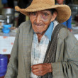 Old man begging at a local street market in Northern Peru - Stock Photo