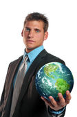 Businessman holding planet earth — Stock Photo