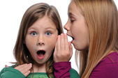 Two girls sharing a gossip — Stock Photo
