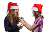Two girls with christmas present — Stock Photo