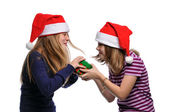 Two girls fighting over a present — Stock Photo