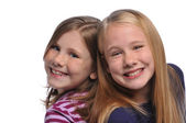 Two girls smiling — Stockfoto