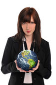 Young businesswoman holding the earth — Stock Photo