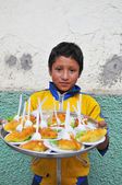 Child selling food on the streets of Northern Peru — Stock Photo