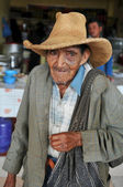 Old man begging at a local street market in Northern Peru — Stock Photo