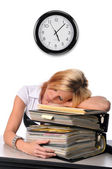 Woman sleeping over a pile of files — Stock Photo