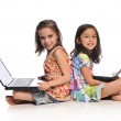 Two little girls with laptop computers — Stock Photo