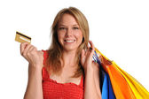 Young Girl holdind shopping bags and credit card — Stock Photo