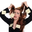 Stock Photo: Businesswomwith adhesive notes expressing stress