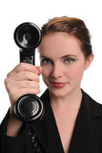 Young Businesswoman with vintage black phone — Stock Photo