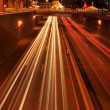 Traffic at night with traces of lights - Stock Photo
