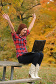 Young Woman wirh laptop computer celebrating — Stock Photo