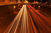 Traffic at night with traces of lights — Stock Photo