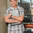 Young man holding his laptop computer — Stock Photo