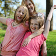 Stock Photo: Young Mother and daughters having fun