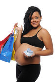 Young Black Woman pregnant with shopping bags — Stock Photo