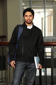 Young Eastern student holding a book — Stock Photo