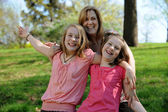 Young Mother and daughters having fun — Stock Photo