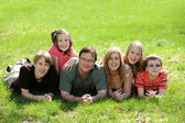 Young Family with suns and daughters — Stock Photo
