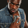 Stockfoto: Young African American Singer with microphone