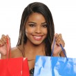 Young African American Woman holding shopping bags — Stock Photo