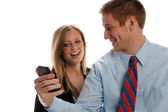 Young Businesspeople with cell phone — Stock Photo
