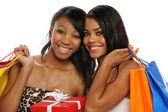 Beautiful African American Teens holding shopping bags — Stock Photo