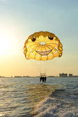 Three on a parasail — Stock Photo